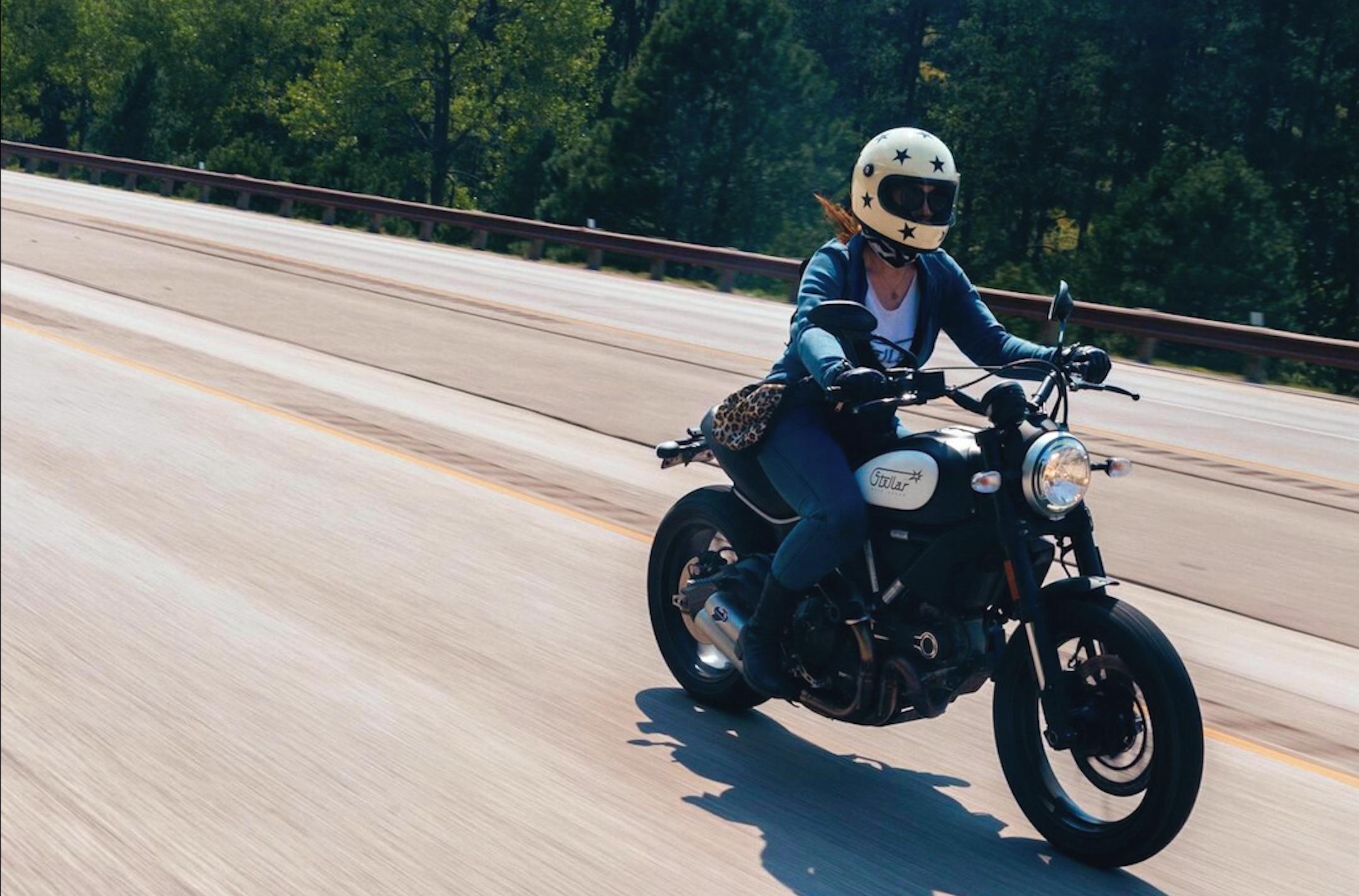Woman riding. Jenna Stellar of Stellar Moto Brand